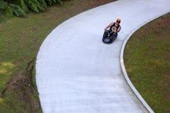 Man ride on Skyline Rotorua Luge Royalty Free Stock Image