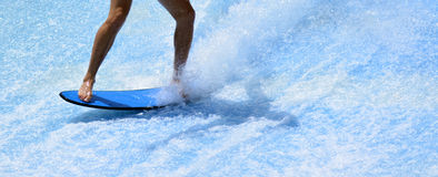 Man ride a surfing board Royalty Free Stock Photos