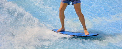 Man ride a surfing board. On FlowRider Stock Photography