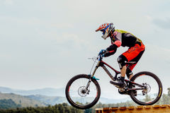 Man rider drops on jump mountain biking Royalty Free Stock Photos