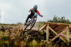 Man rider drops mountain biking. Magnitogorsk, Russia - July 22, 2017: man rider drops mountain biking during National championship downhill royalty free stock photo