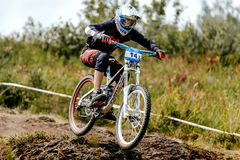 Man rider mountain biking in stone trail. Magnitogorsk, Russia - July 22, 2017: man rider mountain biking in stone trail during National championship downhill royalty free stock photos