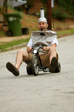 Man Rides Big Wheel In Beer Keg Costume Stock Images