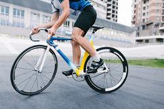 A man rides a bike on a fixed track. Bicycle close up. Stock Photo