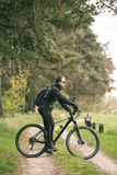 Man Rides a Bike in the Forest Royalty Free Stock Photo