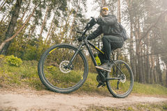 Man Rides a Bike in the Forest Royalty Free Stock Photography