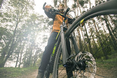 Man Rides a Bike in the Forest Stock Photo