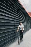 Man rides black fixedgear bicycle Royalty Free Stock Photo