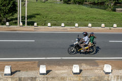A man rides his motor bike on the highway north of Elephant Pass in Northern Sri Lanka. Royalty Free Stock Images