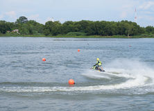 Man rides jet ski around buoys to prepare for competition Royalty Free Stock Image