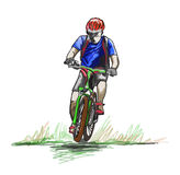 A man rides on a mountain bike or bicycle. Royalty Free Stock Photography