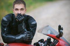 Man rides nice bike Stock Photos