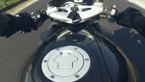 The point of view of a motorcycle. A man rides a sports bike on the road stock footage