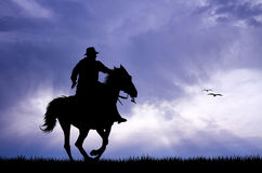 Man rides at sunset Stock Images