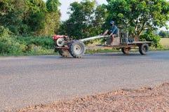 A man rides a tractor. Laos. Stock Photos