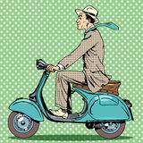 Man rides on a vintage scooter Stock Photos