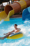 Man rides in the water park Royalty Free Stock Photography