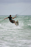 Man Rides Waves Parasail Surfing Off Florida Coast Stock Photo