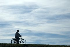 Free Man Riding A Bike Stock Image - 1424691