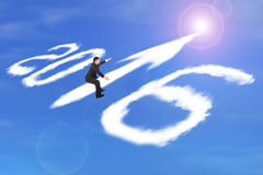 Man riding 2016 arrow up shape clouds in sunlight sky Royalty Free Stock Photos