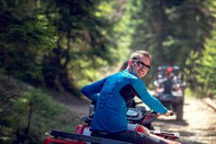 Man riding atv vehicle on off road track ,people outdoor sport activitiies theme.  stock photography