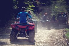 Man riding atv vehicle on off road track ,people outdoor sport activitiies theme Stock Photos