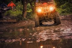 Man riding atv vehicle on off road track ,people outdoor sport a Royalty Free Stock Photo