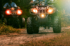 Man riding atv vehicle on offroad track ,people outdoor sport ac Stock Photography