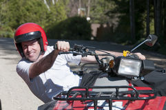 Man riding an ATV Royalty Free Stock Images