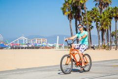 Man riding a beach bike near Venice beach in Los Angeles. By the Santa Monica pier royalty free stock images
