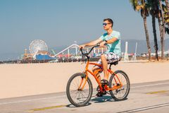 Man riding a beach bike near Venice beach in Los Angeles. By the Santa Monica pier stock photography