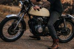 Man Riding Beige Naked Motorcycle Royalty Free Stock Image
