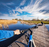 Man riding on a bicycle across the bridge Royalty Free Stock Photography