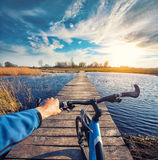 Man riding on a bicycle across the bridge Stock Photo