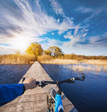 Man riding on a bicycle across the bridge Royalty Free Stock Images