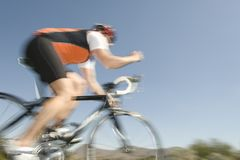 Man Riding Bicycle Against Blue Sky Royalty Free Stock Images