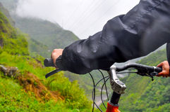Man riding bicycle at Banos, Ecuador Stock Photo