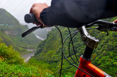 Man riding bicycle at Banos, Ecuador. View of a Man riding bicycle at Banos, Ecuador Stock Images
