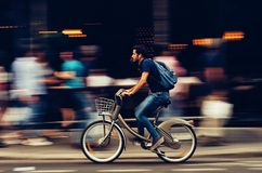 Man Riding Bicycle on City Street Royalty Free Stock Photos