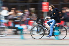 Man riding a bicycle down the street. Amsterdam. Netherlands Stock Images