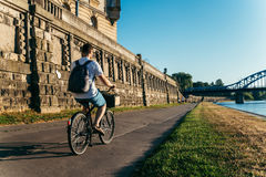 Man riding bicycle at embankment at the sunset Royalty Free Stock Images
