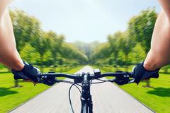 Man riding on bicycle, fast speed, aging effect stock photo