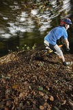 Man Riding Bicycle Through Forest Royalty Free Stock Image
