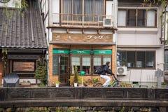 Man riding bicycle in Kinosaki onsen town stock photo