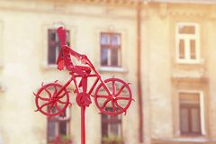 A man is riding a bicycle. Metal figure. Royalty Free Stock Photos