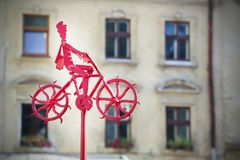 A man is riding a bicycle. Metal figure. Stock Photos