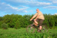 Man riding bicycle, motion blur Stock Photos