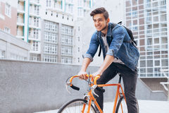 Man riding a bicycle outside Royalty Free Stock Photography