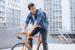 Man riding a bicycle outside Royalty Free Stock Images