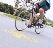 Man riding a bicycle in the park, selective Focus. Man riding a bicycle in the park Stock Photo